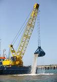 Heavy duty bucket of the dredging Stock Photography