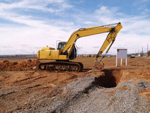 Heavy duty construction equipment by work site Royalty Free Stock Image