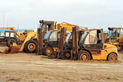 Heavy duty construction machinery. On a construction site or roadworks where earth moving is taking place Stock Photo