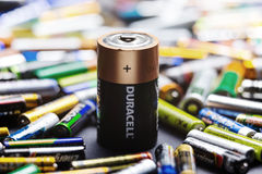 Heavy duty D type battery. KYIV, UKRAINE - March 03, 2016: Heavy duty D type battery on many used colorful AA and AAA sized batteries in a pile at black stock images