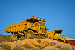 Heavy duty dump trucks. Old heavy duty dump trucks on a quarry stock photo