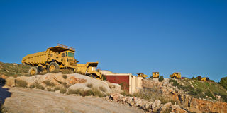Heavy duty dump trucks. Old heavy duty dump trucks on a quarry royalty free stock photo