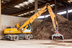Heavy duty excavator doing earth moving Royalty Free Stock Images