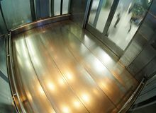 Heavy duty industrial lift elevator made of stainless steel and glass Royalty Free Stock Image