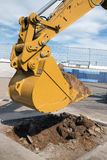 Backhoe Heavy Equipment Construction Zone. Heavy duty large backhoe equipment digs dirt at new construction site royalty free stock image