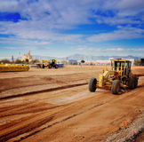 Heavy duty machinery creating new road. With blue sky background Stock Photography