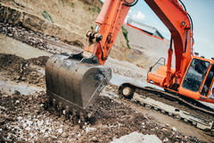 heavy duty machinery, details of excavator building highway and roads Stock Images
