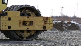 Heavy duty machinery working on highway construction site. stock footage