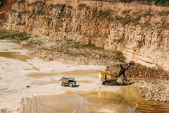 Heavy duty machines work in a quarry, quarry equipment concept. Copy space royalty free stock images