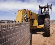 Heavy Duty Moving Machinery. On new home build construction site Stock Photography