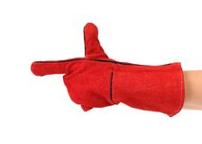 Heavy-duty red glove on hand as gun. Royalty Free Stock Image