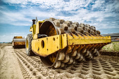 Heavy duty road building machine -  vehicle. Hot Asphalt being l Stock Photography