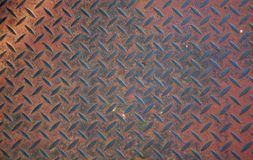 Heavy duty rusty non slip metal plate. Heavy duty rusty metal background with non slip repetitive patten. Concept image for urbanization, steampunk, construction Royalty Free Stock Images