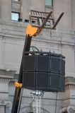 Heavy Duty Speaker Stand. Speakers at a concert suspended above the crowd from a fork lift by chains and heavy cables Royalty Free Stock Photography