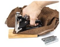 Heavy duty staple gun with staples on the white background. stock images
