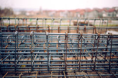 Heavy duty steel bars on construction site, infrastructure details and tools. Reinforced heavy duty steel bars on construction site, infrastructure details and Royalty Free Stock Photos