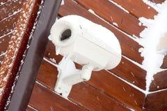 Heavy duty surveillance cam. Heavy duty outdoor  surveillance cam under snow Stock Photo