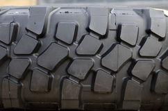 Heavy Duty Tire Tread. Rubber tire tread texture of a tractor or other heavy duty construction machinery Stock Photo