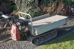 Heavy duty transport cart with caterpillars in the garden Royalty Free Stock Photography
