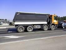 Heavy duty truck on public road stock images