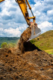 Heavy duty vehicule scoop working with soil. And sand on construction site Royalty Free Stock Images