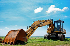 Heavy earth mover and blue sky, excavator machine Stock Image
