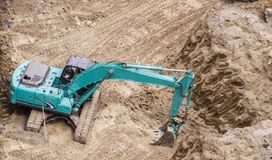 Heavy earth mover digging Royalty Free Stock Image