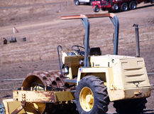 Heavy Earth Moving Equipment Idle In Field Stock Photo