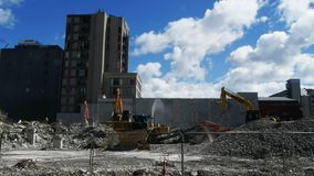 Machinery is used to demolish damaged buildings in christchurch