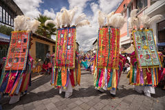 Heavy elaborate bright colour costumes at Corpus Christi. June 17, 2017 Pujili, Ecuador: heavy elaborate brightly colored headdresses worn by male dancers at Stock Images