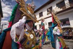 Heavy elaborate headdress worn by men at Corpus Christi. June 17, 2017 Pujili, Ecuador: heavy elaborate brightly colored headdresses worn by male dancers at Stock Photography