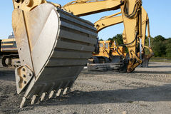 Heavy Equipment. A row of different heavy equipment machines on a construction site Stock Photo