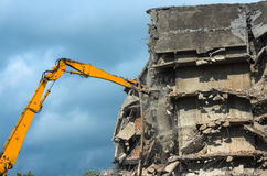 Heavy equipment being used to tear tearing down building construction Stock Photos