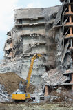 Heavy equipment being used to tear tearing down building construction Royalty Free Stock Photography