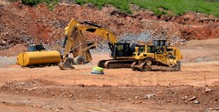 Heavy equipment at construction site Stock Images