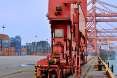 Heavy equipment in container yard beside dock, Xiamen, China Stock Photos