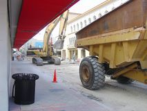 Heavy Equipment in Downtown. Downtown street work and equipment in confined area Royalty Free Stock Photo