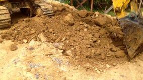 Heavy equipment excavator dig around with sound.  stock video footage