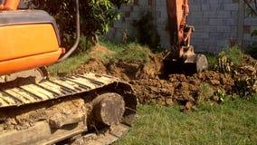 Heavy equipment excavator dig around with sound.  stock video