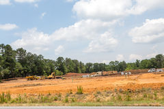 Heavy Equipment Grading a New Home Site Royalty Free Stock Image