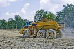 Heavy Equipment Hauling Dirt. A large truck hauling dirt Royalty Free Stock Photo