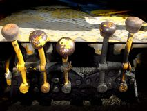 Heavy Equipment Knob and Lever Controls. Several heavy equipment knob and lever controls with oil stock photos