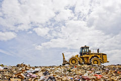 Heavy Equipment in Landfill. A Compactor working over trash at a landfill Stock Photos