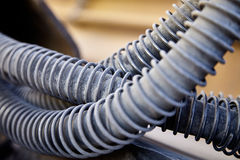 Heavy equipment machinery hydraulic hose abrasion protection clo Royalty Free Stock Photography