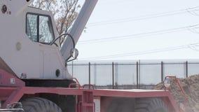 Heavy Equipment Near Border. Cars drive past heavy equipment near the border of Mexico and the US stock video