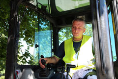 Heavy Equipment Operator. The operator of a excavator on a working site Stock Images
