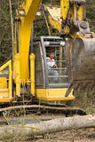 Heavy equipment operator on excavator Stock Photos