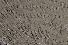 Heavy Equipment Tire Pattern in Dirt Background stock photo