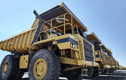 Heavy equipment row industrial mining dump trucks Stock Photography