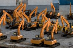 Heavy equipment sitting on loading docks Royalty Free Stock Photos